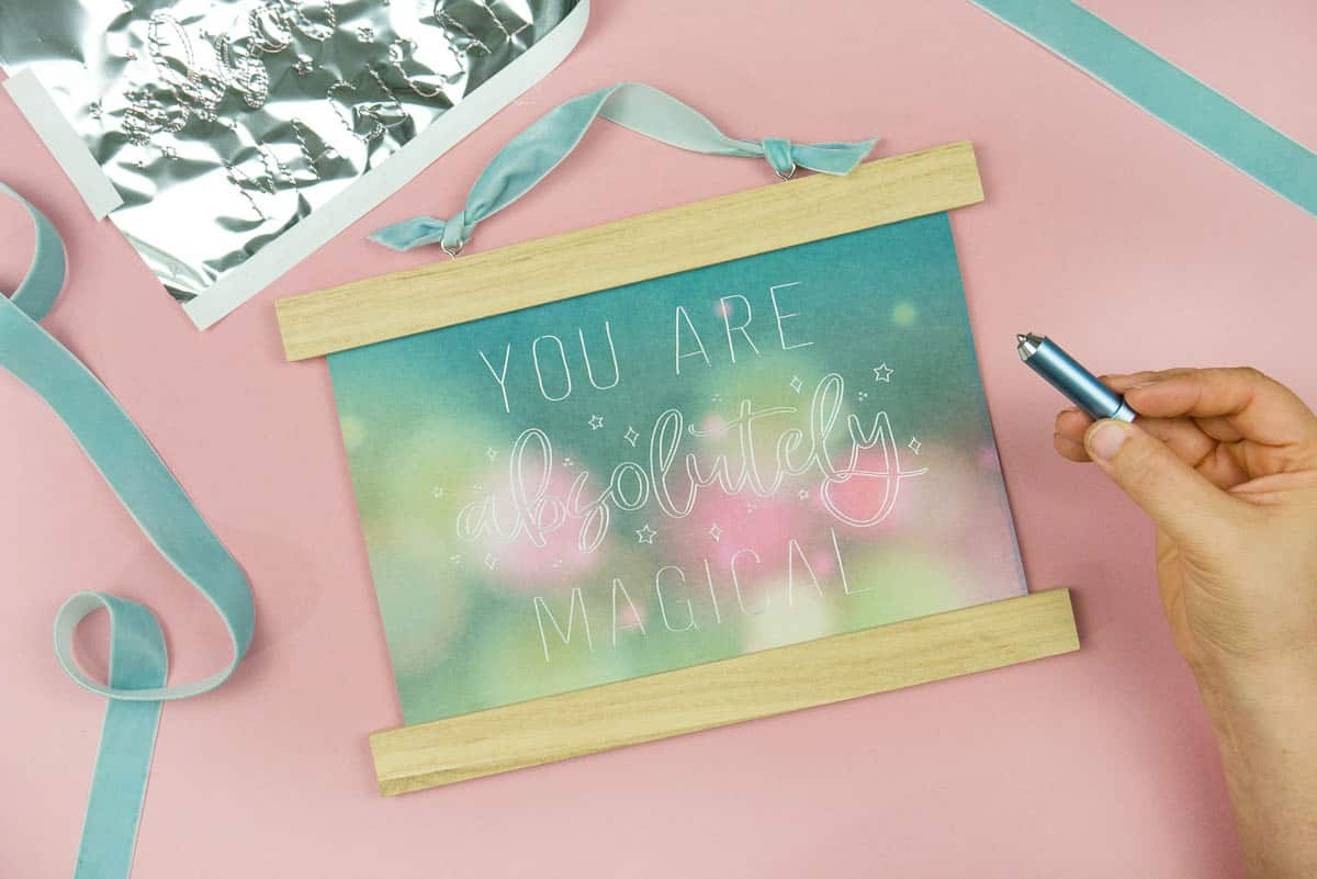 Colorful cardstock with the You Are Magical Single Line Free SVG.