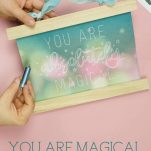 Hand holding Cricut Foil Transfer Kit with You Are Magical Single Line Free SVG