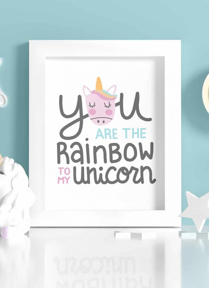 """White frame with """"You are the rainbow to my unicorn"""" art in a blue room."""
