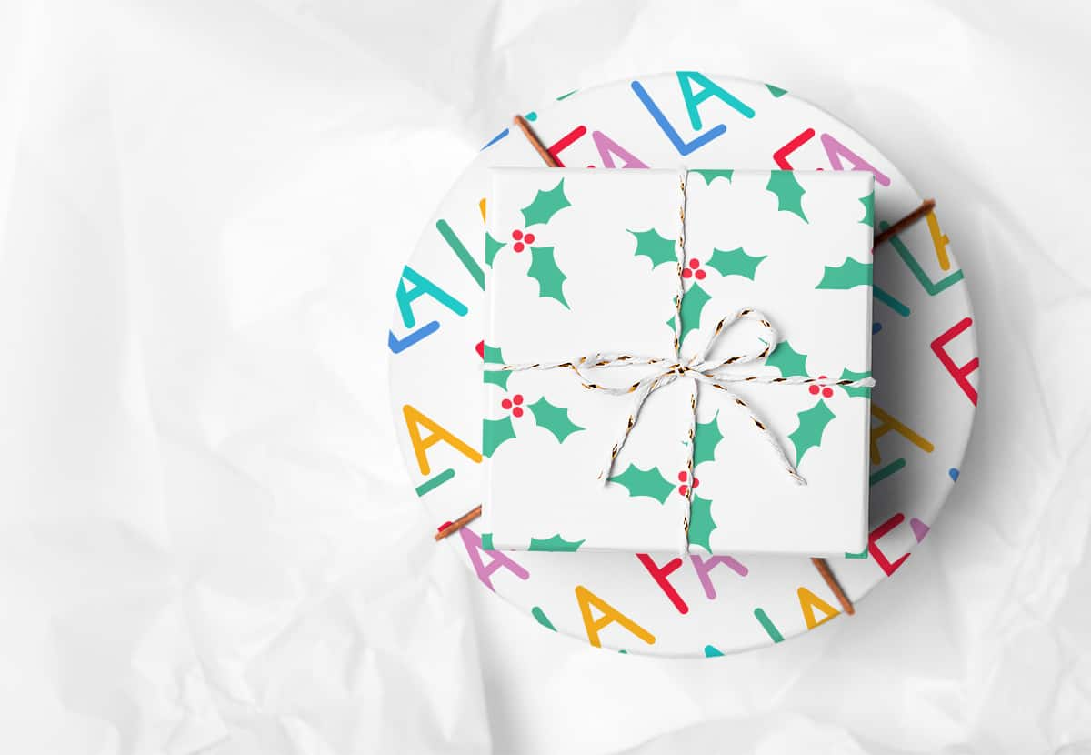 Two packages wrapped in festive wrapping paper on a white background.