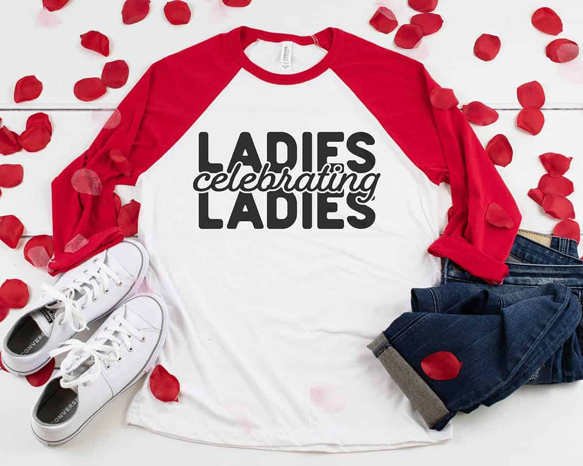 Red and white raglan t-shirt with black vinyl lettering