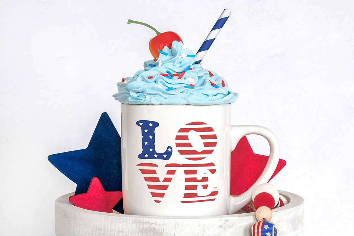White mug with the Patriotic 4th of July Love Free SVG on it.