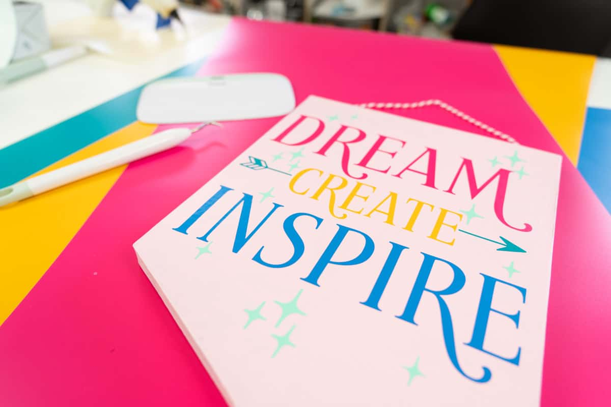 """Image of pennant flag with words """"Dream Create Inspire"""" on a craft desk"""
